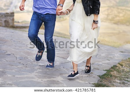 Beautiful happy running couple in love outdoors. Close up - stock photo