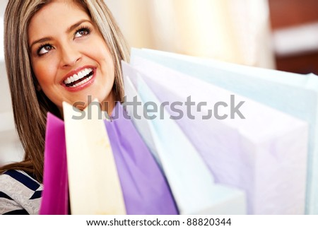 Beautiful happy shopping woman in a mall