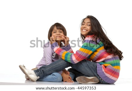 Beautiful happy sisters over white background