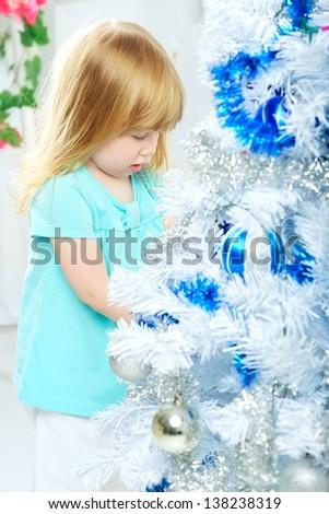 beautiful happy small girl decorate christmas tree - stock photo