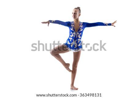 Beautiful happy smiling ballerina teenage girl wearing dancer blue leotard working out, dancing, posing, doing art gymnastics exercise, full length, studio, white background, isolated - stock photo