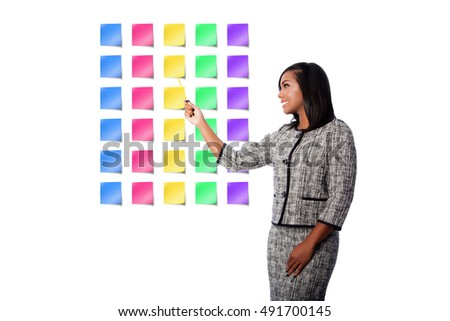Beautiful happy smiling business woman presenting colorful blank sticky notes, on white.