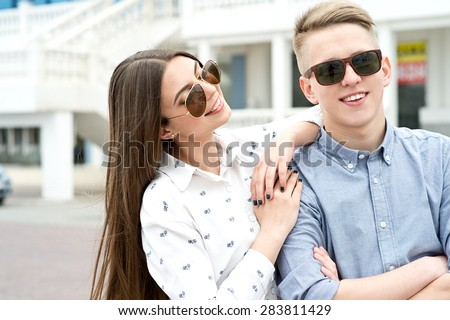 Beautiful happy smiling couple in love having fun together end enjoy their love and romantic date. Close up portrait of loving couple - stock photo