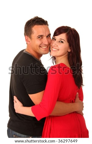 Beautiful happy smiling couple in love looking back - stock photo