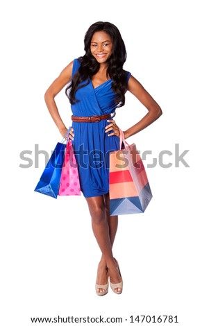 Beautiful happy smiling fashion woman shopping with bags, wearing blue dress and belt, on white. - stock photo