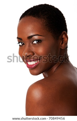 Beautiful happy smiling inspiring African woman with short curly hair and great skin showing teeth, isolated. - stock photo