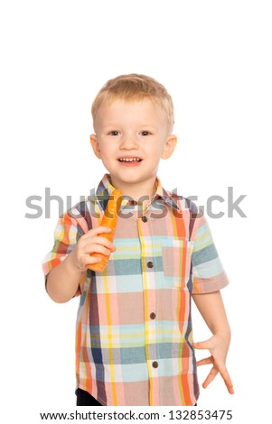 Beautiful happy smiling joyful child (little boy) eating healthy food (vegetable, carrot) isolated on white background - stock photo