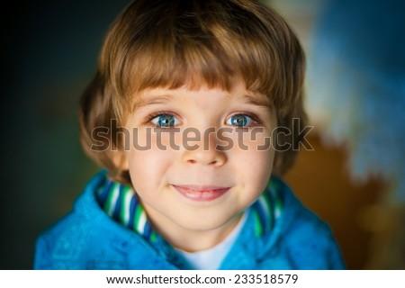 beautiful  happy smiling   little boy with a big blue eyes and long eyelashes - stock photo