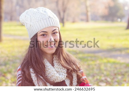 Beautiful happy smiling woman outdoor portrait. - stock photo