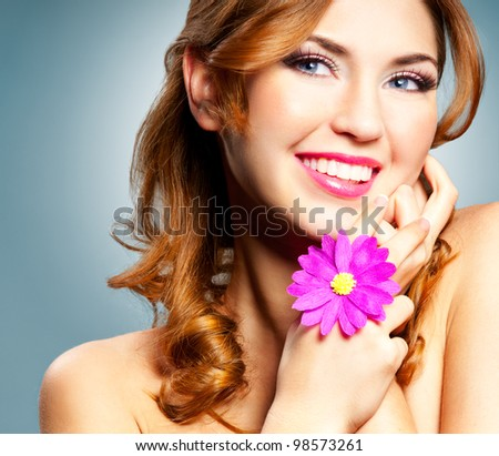 Beautiful happy smiling woman with long curly hair - stock photo