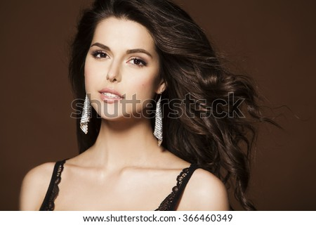 Beautiful happy smiling woman with perfect makeup wearing jewelry - stock photo
