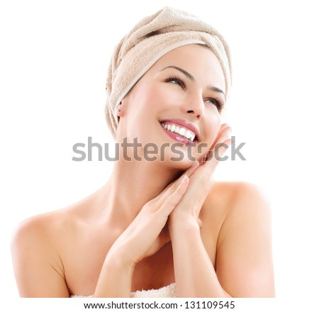 Beautiful Happy Spa Girl Isolated on a White Background.Touching her Face. Happy Woman after Bath with Clean Perfect Skin - stock photo