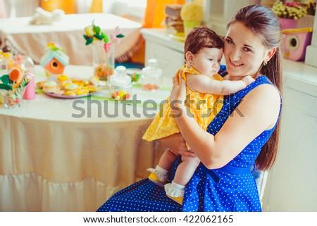 Beautiful happy woman enjoys her child - stock photo