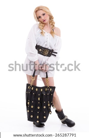 Beautiful happy woman holding a bag on a white background - stock photo