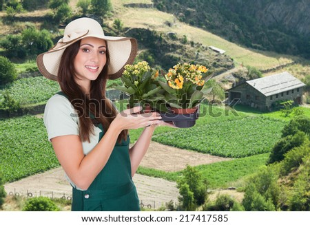 Beautiful Happy Woman Holding Flower Plant. Isolated On White - stock photo