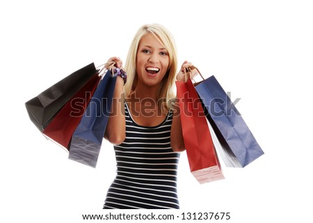 Beautiful happy woman holding shopping bags. Isolated - stock photo