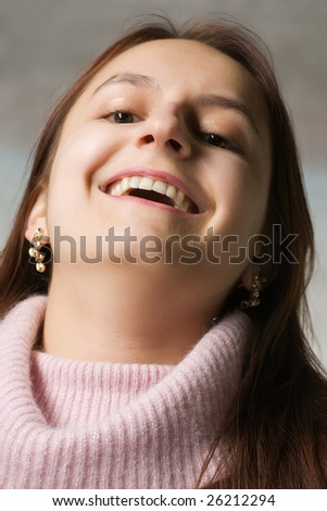 beautiful happy woman in pink sweater close-up portrait