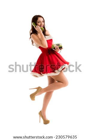 Beautiful happy woman in Santa Claus dress calling phone - stock photo