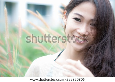 Beautiful happy woman in the park on a summer day
