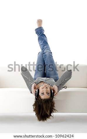 Beautiful happy woman listen music with headphones - stock photo