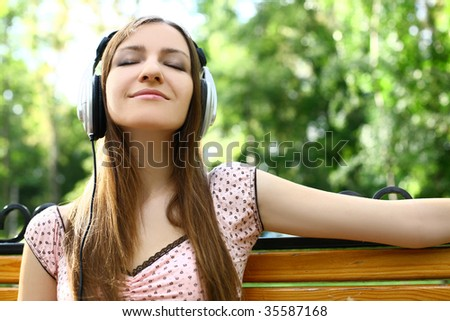 beautiful happy woman listening to music - stock photo