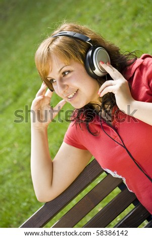 beautiful happy woman listening to music - stock photo