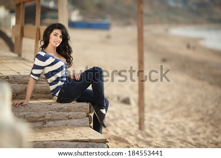 Beautiful happy woman outdoor portrait lifestyle, attractive female walking at beach enjoying sun. spring summer time series.