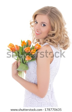 beautiful happy woman with orange tulips isolated on white background