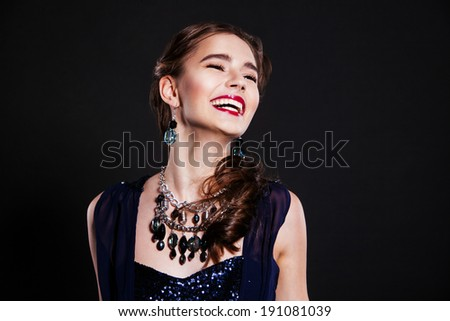 beautiful happy woman with perfect makeup wearing jewelry - stock photo