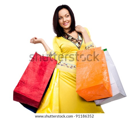 Beautiful happy woman with shopping bags isolated on a white background - stock photo