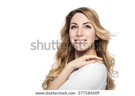 Beautiful happy young blonde woman isolated over white background. - stock photo