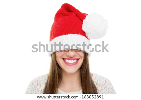 Beautiful happy young Caucasian brunette woman wearing Santa Claus beanie hat that is too big for her. Christmas and teeth care concepts. - stock photo