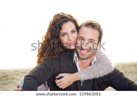 Beautiful happy young couple at the beach - stock photo