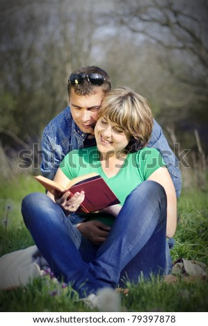 Beautiful happy young couple in forest