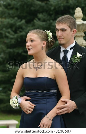 Beautiful, happy young couple in formal attire - stock photo