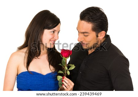 beautiful happy young girl holding a red rose from boyfriend husband isolated on white - stock photo