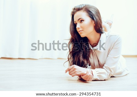 Beautiful happy young woman at home. - stock photo