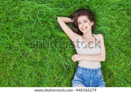 Beautiful happy young woman enjoying nature, summer girl portrait - stock photo