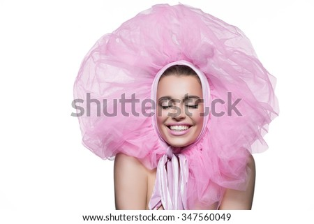 Beautiful happy young woman in fluffy pink headwear. Beauty shot. Isolated over white background. Copy space. - stock photo