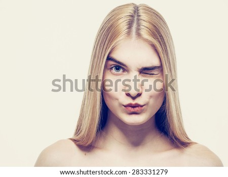 beautiful happy young woman portrait face wink  - stock photo