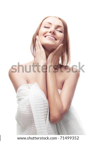 beautiful happy young woman touching her face