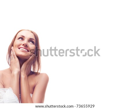 beautiful happy young woman touching her neck and looking up, a lot of copy space to the right - stock photo