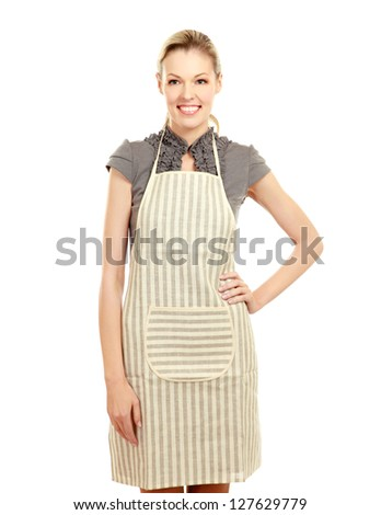 Beautiful happy young woman wearing kitchen apron , isolated on white - stock photo
