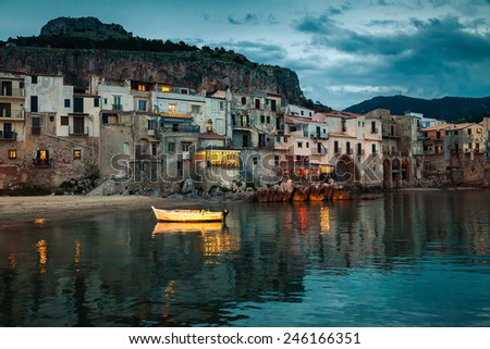 beautiful harbor view of old houses in Cefalu at dusk, Sicily - stock photo