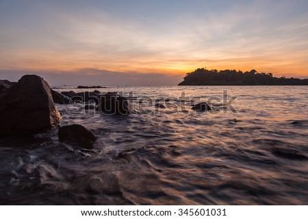 Beautiful HDR sunset over sea beach - stock photo