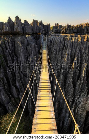 Beautiful HDR view on the bridge over the canyon at the Tsingy de Bemaraha Strict Nature Reserve in Madagascar - stock photo