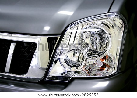 Beautiful headlight of the grey sports car - stock photo