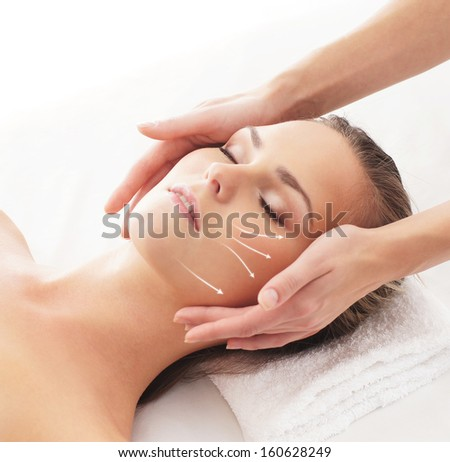 Beautiful, healthy and young woman is getting spa treatment (concept with the arrows) - stock photo