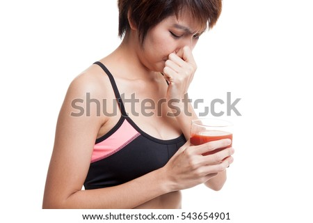 Beautiful healthy Asian girl hate  tomato juice  isolated on white background.