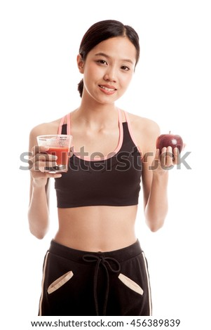 Beautiful healthy Asian girl with tomato juice and apple  isolated on white background - stock photo